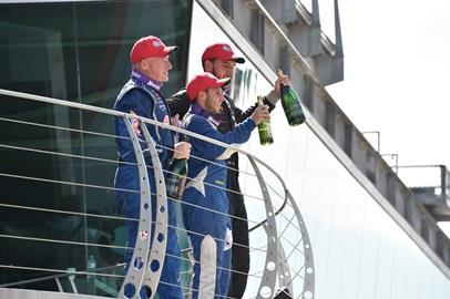 Drivers pop champagne in Victory Circle during the Friday session of the SCCA Runoffs