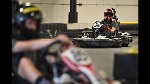 NASCAR driver Ryan Reed takes on the road course at Speedway Indoor Karting with race fans and media members